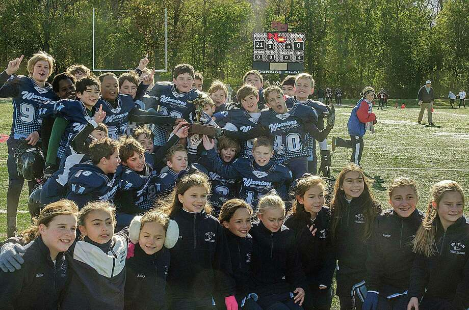 The Wilton 5th grade tackle football team won the FCFL Championship on earlier this month, defeating Westport 21-0. Photo: Contributed Photo / Hearst Connecticut Media / Norwalk Hour