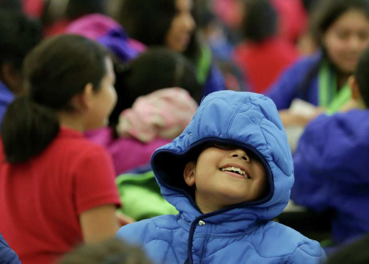 Daniel Mondragon smiles after receiving one of 615 coats given away by Houston firefighters, Dec. 9, 2015, in Houston. ( Jon Shapley / Houston Chronicle )
