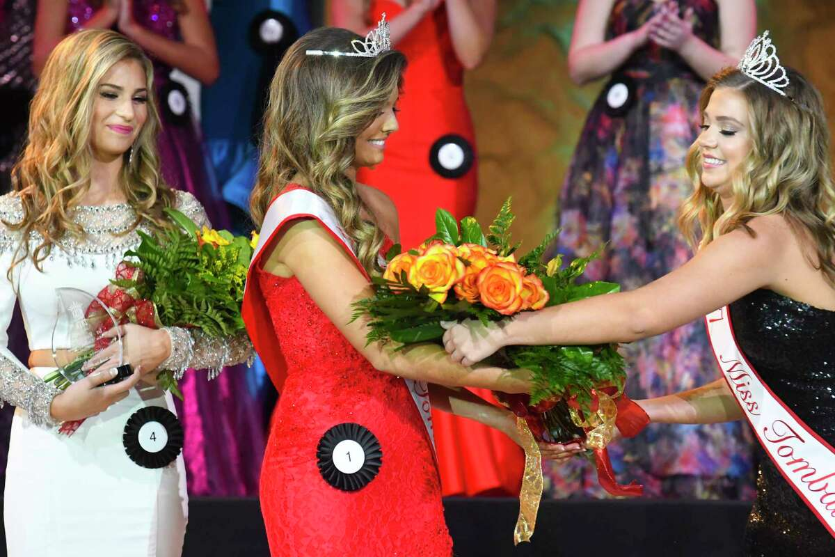 2018 Miss Tomball Kasey Vann is crowned by and received flower from 2017 queen Kyla Hall at the Miss Tomball Pageant on Nov. 18.
