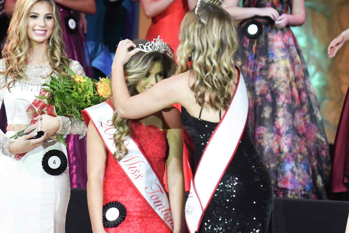 2018 Miss Tomball Kasey Vann is crowned by 2017 queen Kyla Hall at the Miss Tomball Pageant on Nov. 18.