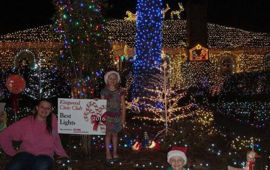 "The 2016 winning house of the Kingwood Civic Club Holiday Decorating Contest ""best lights"" category gets a yard sign sponsored by RE/MAX Associates Northeast. Photo: Courtesy Of Cindy Higgins"