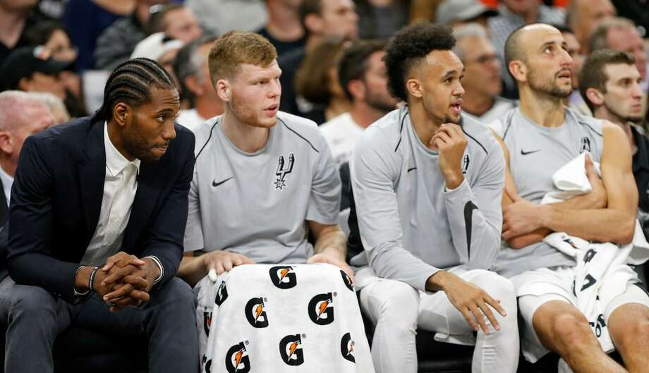 San Antonio Spurs' Kawhi Leonard (from left), Davis Bertans, Derrick White, and Manu Ginobili watch second half action against the Toronto Raptors from the bench Monday Oct. 23, 2017 at the AT&T Center. The Spurs won 101-97. Photo: Edward A. Ornelas /Express-News