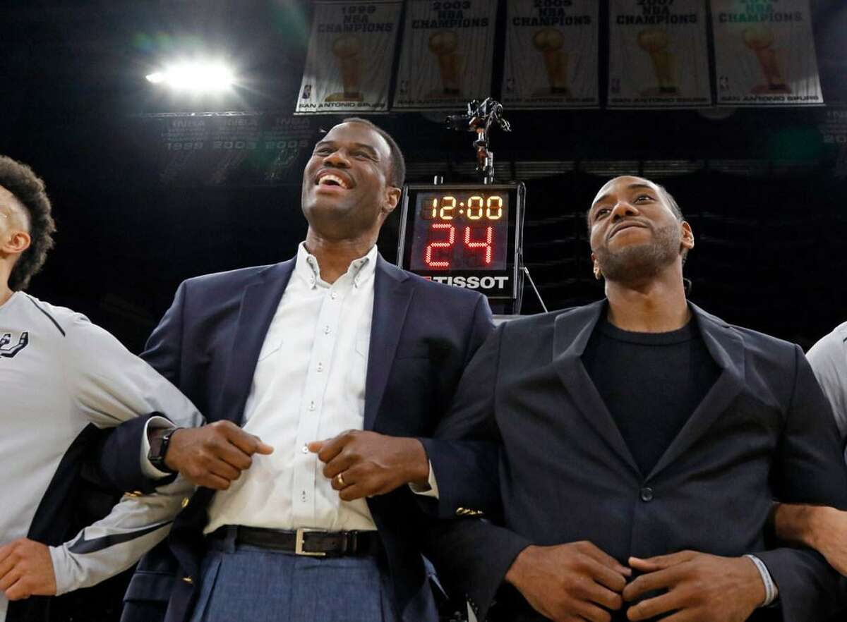 Former Spur David Robinson joins injured Kawhi Leonard during pre-game activities before an Oct. 18, 2017 game against the Minnesota Timberwolves at the AT&T Center.