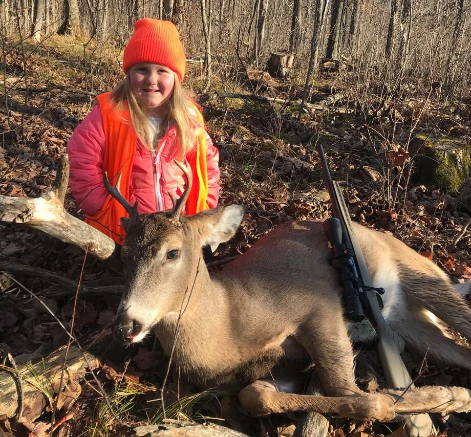 Lexie Harris, 6, poses after bagging a buck in Taylor County, Wis. Lexie is among the first youngsters to bag a buck under the state's new law that eliminates the state's minimum hunting age. Photo: Tyler Harris Via AP