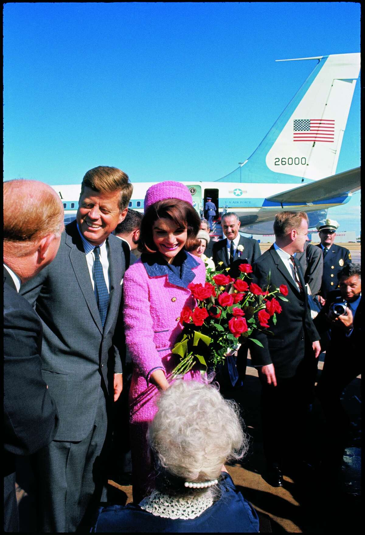 President John F. Kennedy and bouquet-carrying Jackie Kennedy arriving at Love Field, on the campaign tour with Vice President Lyndon and Lady Bird Johnson,November 22, 1963.