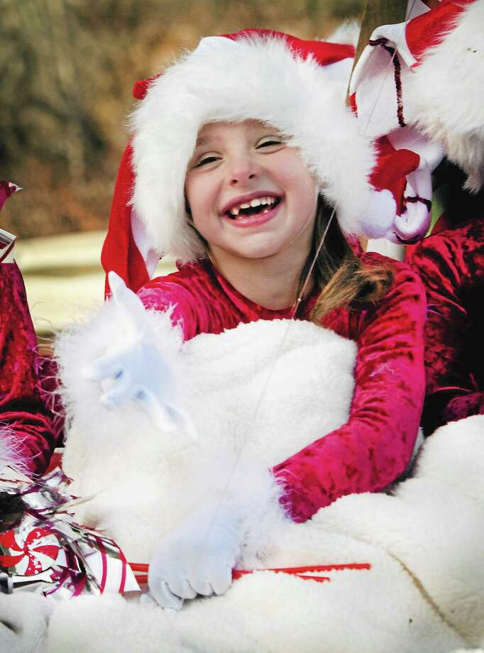 (Melanie Stengel — New Haven Register) ¬ Lillian Quill,6,  gestures to the crowd from the Rita Tottenham Studios float during the annual Seymour Christmas Parade 11/30. Photo: Journal Register Co.