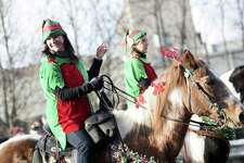 Emma Delgado, of Shelton, rides with DeMartino's Farm, of Seymour, in the 45th annual Seymour Christmas Parade in downtown Seymour, Connecticut Sunday, Nov. 27, 2016.