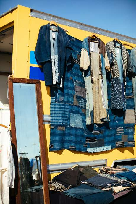 Blue Heritage's indigo items hang at Alameda Pointe Antiques Faire. Photo: Mason Trinca, Special To The Chronicle