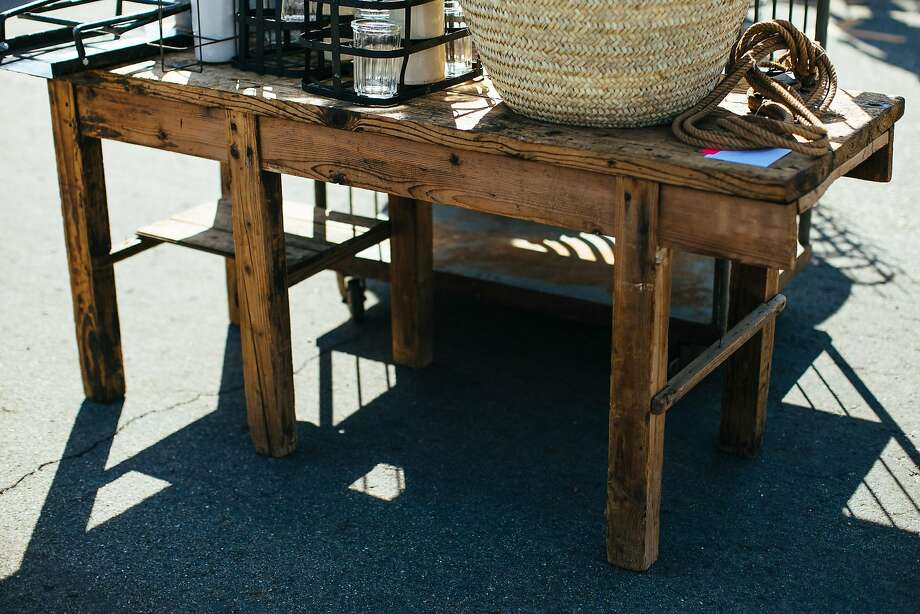 "One of Jeni Maus' favorite finds on a recent Sunday at the Alameda Pointe Antiques Faire was this rustic French work desk: ""I love the roughness of the wood,"" Maus says. Photo: Mason Trinca, Special To The Chronicle"