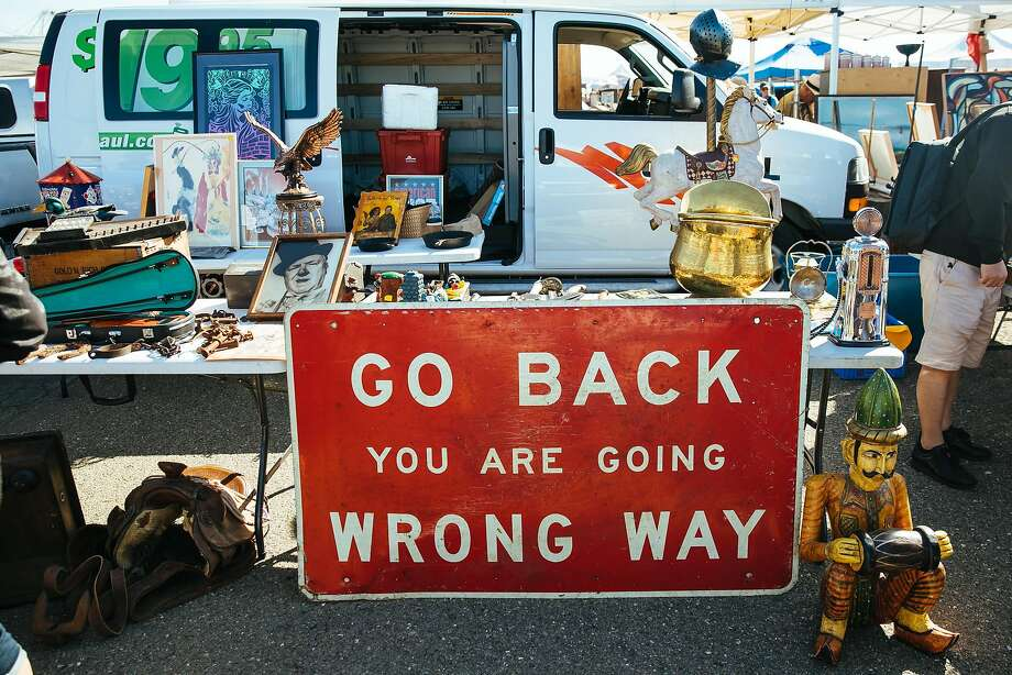 Jeni Maus bought this sign, Go Back You Are Going Wrong Way, for the entrance to her home. Photo: Mason Trinca, Special To The Chronicle