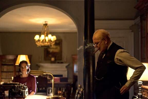 """L-R: Secretary Elizabeth Layton (Lily James) and her boss, Winston Churchill (Gary Oldman), in """"The Darkest Hour."""" Photo by Jack English, courtesy of Focus Features."""