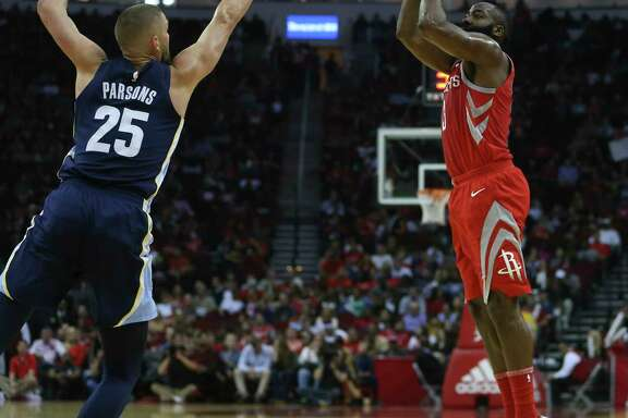 Houston Rockets guard James Harden (13) scores a three-pointer while Memphis Grizzlies forward Chandler Parsons (25) is trying to stop him during the first quarter of an NBA game at Toyota Center on Saturday, Nov. 11, 2017, in Houston. ( Yi-Chin Lee / Houston Chronicle )