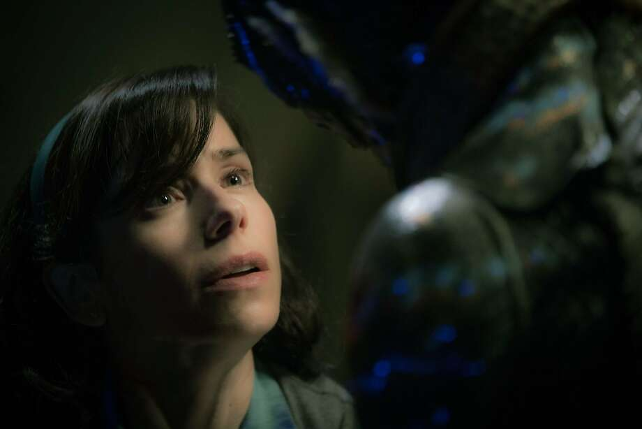 "Elisa (Sally Hawkins) in an intimate moment with the Amphibian Man (Doug Jones) who has captured her heart in ""The Shape of Water."" Photo courtesy of Fox Searchlight. Photo: Fox Searchlight"