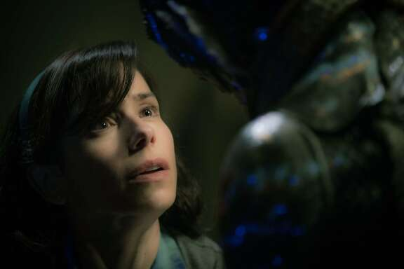 """Elisa (Sally Hawkins) in an intimate moment with the Amphibian Man (Doug Jones) who has captured her heart in """"The Shape of Water."""" Photo courtesy of Fox Searchlight."""