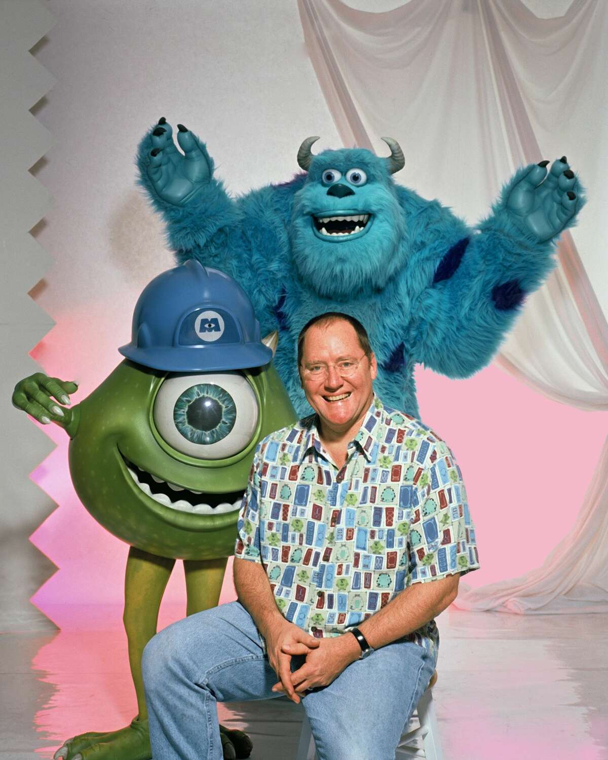Writer, producer, director John Lasseter poses for a photo session with characters from the movie Monsters Inc on November 1, 2001 in Los Angeles.