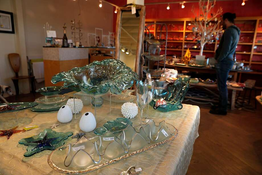 A variety of glass pieces made by Annie Morhauser are seen for sale in the retail shop at Annieglass in Watsonville. The company's glass work is also featured at high-end retailers like Neiman Marcus. Photo: Carlos Avila Gonzalez, The Chronicle