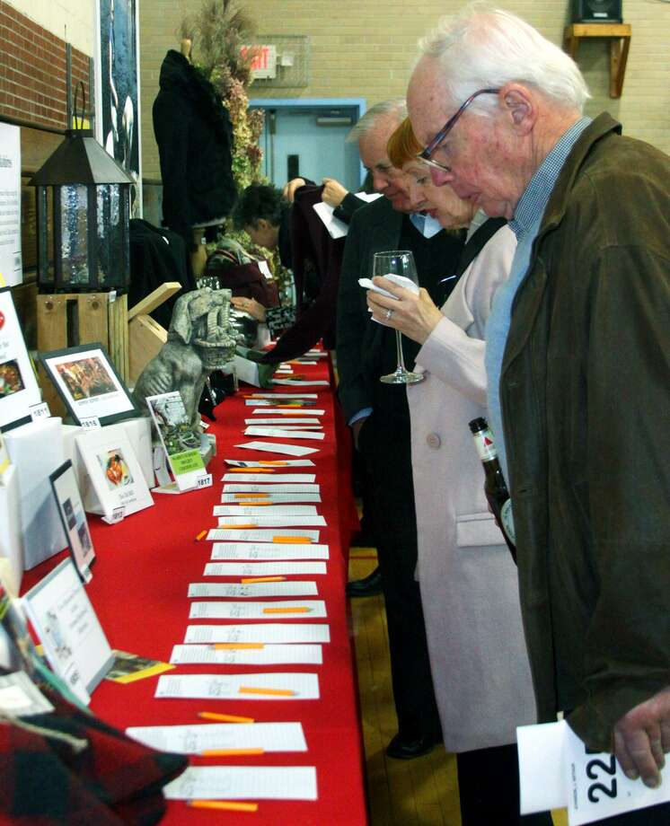 Arthur Johnson of Watertown studies the silent auction possibilities during the Housatonic Valley Association's annual benefit auction, Nov. 23, 2014 at Washington Primary School. Photo: Walter Kidd / Walter Kidd / The News-Times Freelance