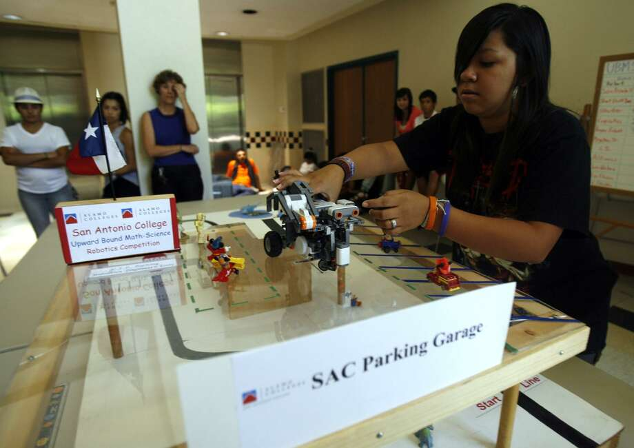 Sierra Gonzalez, 15, an Upward Bound Math and Science student from Edison High School, participates in the 2011 Sumobot Competition at the San Antonio College. That was the first year for the UBMS program at Edison. Photo: San Antonio Express-News File Photo / SAN ANTONIO EXPRESS-NEWS