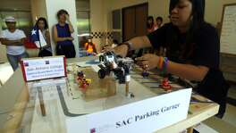 Sierra Gonzalez, 15, an Upward Bound Math and Science student from Edison High School, participates in the 2011 Sumobot Competition at the San Antonio College. That was the first year for the UBMS program at Edison.