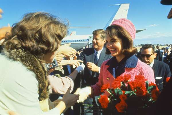 TEXAS, UNITED STATES - NOVEMBER 22:  President John F. Kennedy and wife Jackie greeting crowd at Love Field upon arrival for campaign tour on day of his assassination.  (Photo by Art Rickerby/The LIFE Picture Collection/Getty Images)