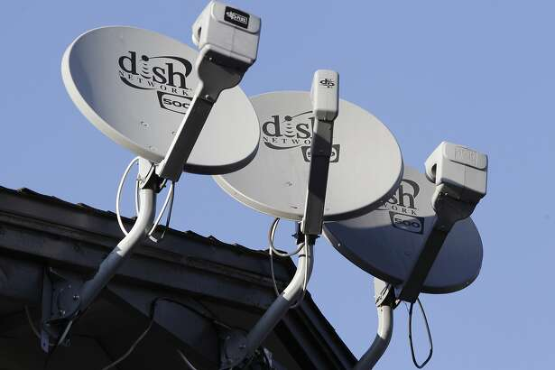 FILE - This Feb. 23, 2011 file photo shows three Dish Network satellite dishes at an apartment complex in Palo Alto, Calif. Dish Network is offering a new �skinny� bundle of about 50 cable channels that doesn�t include ESPN and some other sports channels, giving people who don�t care about sports a way to save money on TV without joining the ranks of �cord cutters.� (AP Photo/Paul Sakuma, File)