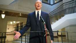 Carter Page, former foreign policy adviser for the Trump campaign, speaks after testifying before the House Intelligence Committee on Nov. 2. A reader says the investigations into Russian meddling in the presidential election are a waste of time and money.