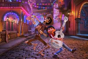 """In this image released by Disney-Pixar, character Hector, voiced by Gael Garcia Bernal, left, and Miguel, voiced by Anthony Gonzalez, appear in a scene from the animated film, """"Coco."""" (Disney-Pixar via AP) ORG XMIT: NYET952"""