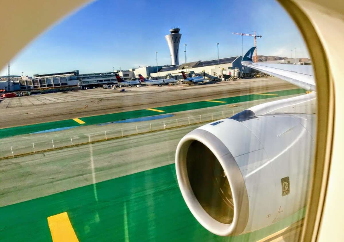 See the curledd wingtip of thie Cathay Pacific Airbus A350? (Chris McGinnis)