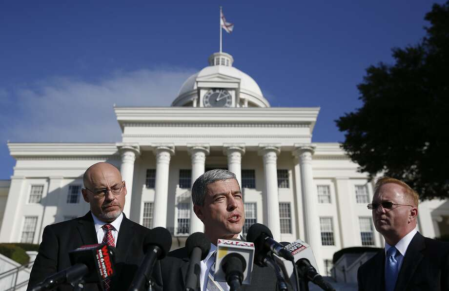 Members of the Roy Moore campaign, Dean Young, left, Ben DuPre, center, and Stan Cooke, speak at a news conference, Tuesday, Nov. 21, 2017, in Montgomery, Ala. (AP Photo/Brynn Anderson) Photo: Brynn Anderson, Associated Press