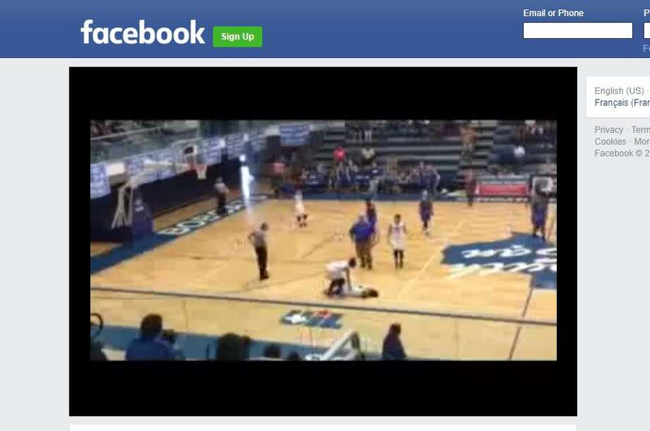 Facebook user Doc Espinoza called the collision 'a cheap shot' in a viral video post showing the incident. South San Girl's basketball coach Jacob Alegria believes a Kerrville  Tivy player intentionally ran into his player causing injuries including  a collision and whiplash. Photo: Facebook