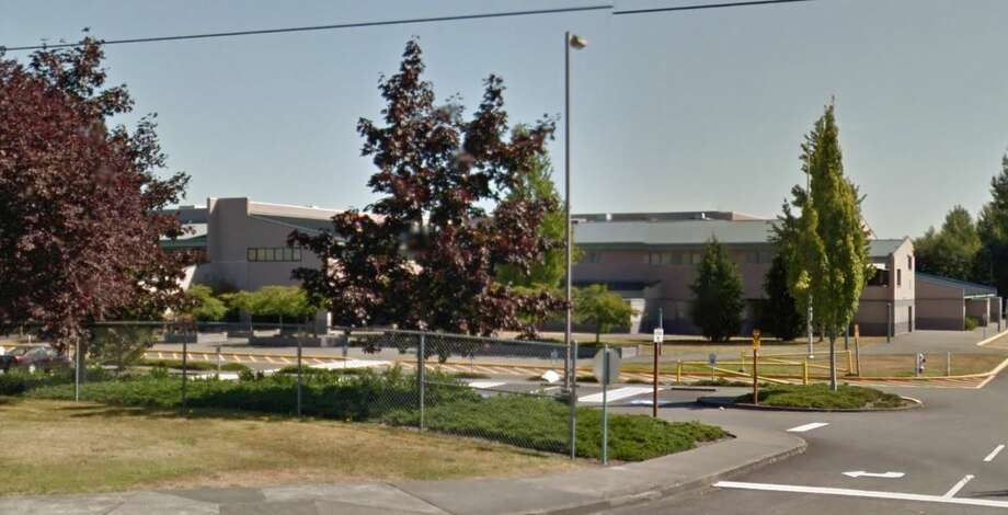 Prosecutors say that a 24-year-old man who worked as a part-time  intern in two Kent School District schools targeted a 13-year-old boy at  Northwood Middle School with notes and a camera in a bathroom urinal. Photo: Google Maps