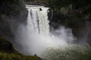 Snoqualmie Falls runs strongly as continuous rain hits the region in one of several warm fronts to hit western Washington this week, seen on Tuesday, Nov. 21, 2017.
