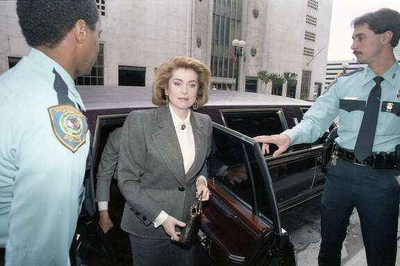Catherine Deneuve arrives at the downtown Foley's to sign autographs and introduce her new fragrance, Nov. 18, 1987.