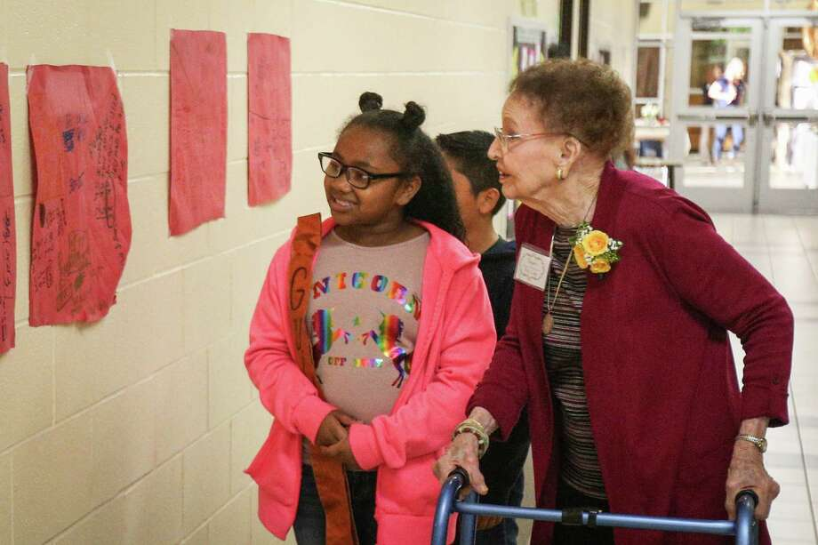 Jeanette DeFee, 99, wife of the late T.J. DeFee, first principal of Runyan Elementary, is taken on a tour of the school by fourth-grader Brayla Morales during the 50th anniversary celebration on Friday,  Nov. 17, 2017, at Runyan Elementary in Conroe. Photo: Michael Minasi, Staff Photographer / © 2017 Houston Chronicle