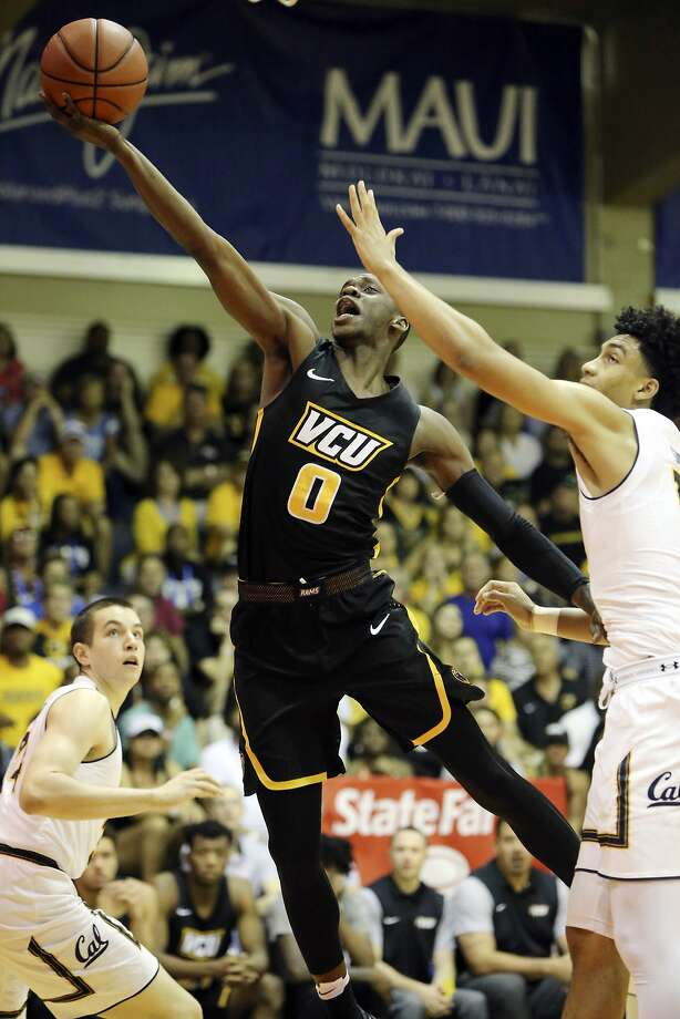 Cal forward Justice Sueing (right) tries to defend VCU guard De'Riante Jenkins (center) in the second half. Photo: Marco Garcia, Associated Press