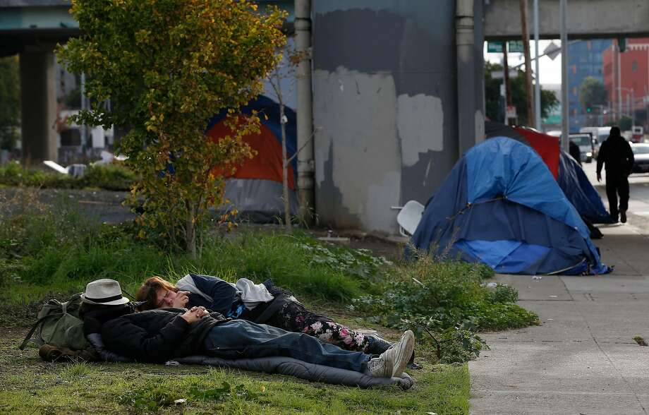"""A tent encampment on Fifth Street in San Francisco in November 2017. A class-action lawsuit accuses a Las Vegas hospital of improperly discharging patients via """"Greyhound therapy,"""" in which mentally ill individuals were handed one-way tickets to strange cities without proper care or arrangements organized for their arrivals. Photo: Lea Suzuki, The Chronicle"""