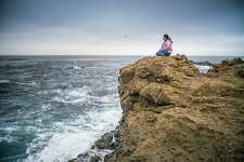 Hillary Renick sits  at an ancestral Pomo tide pool at the Noyo Headlands in Calif. on Friday, Nov. 3, 2017. Renick is a member of Sherwood Pomo (Sherwood Rancheria).