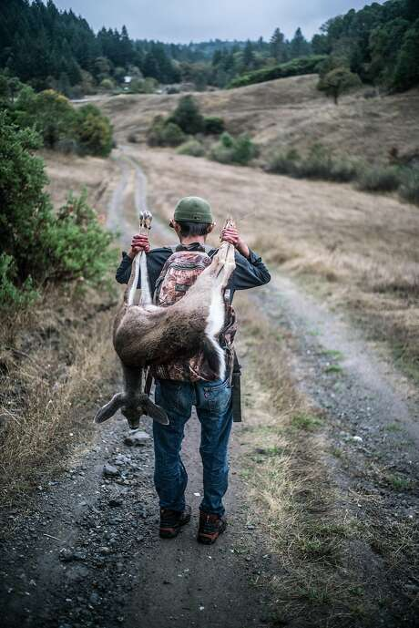 Brian Nez proudly carries a deer during a deer hunt at Sherwood Rancheria in Mendocino County. Photo: Renan Ozturk