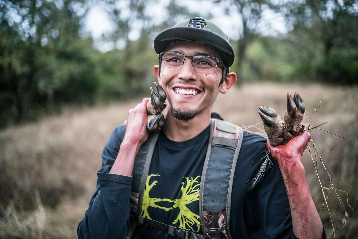 Brian Nez carries a deer during a hunt at Sherwood Rancheria in Mendocino County.