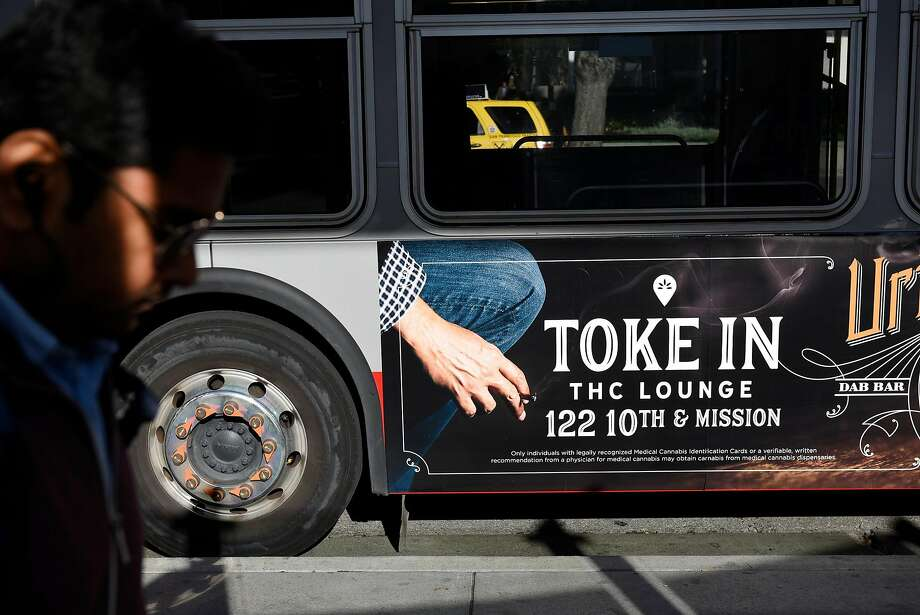 An advertisement for Urban Pharm marijuana dispensary is seen on the side of a MUNI bus in downtown San Francisco, CA, on Friday November 17, 2017. Photo: Michael Short, Special To The Chronicle