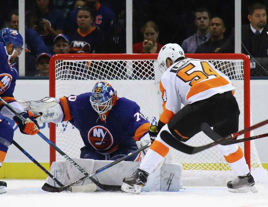 Islanders goalie Kristers Gudlevskis makes a save on the Flyers' Oskar Lindblom during a preseason game Sept. 17 at the Nassau Veterans Memorial Coliseum in Uniondale, New York. Photo: Bruce Bennett / Getty Images / 2017 Getty Images