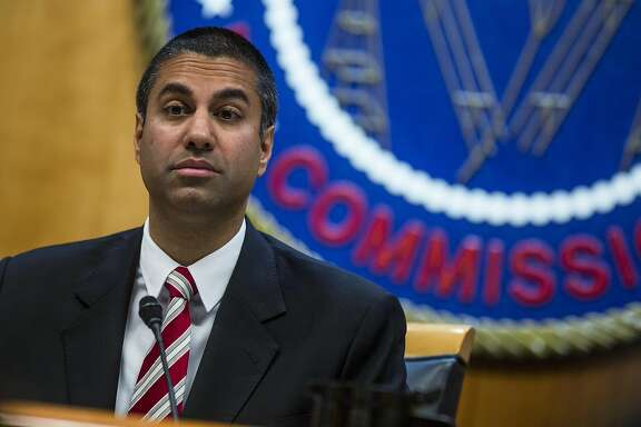 Ajit Pai, chairman of the Federal Communications Commission (FCC), pauses while speaking during an open meeting in Washington, D.C., U.S., on Thursday, Nov. 16, 2017. The FCC plans to vote in December to kill the net neutrality rules passed during the Obama era. Photographer: Zach Gibson/Bloomberg