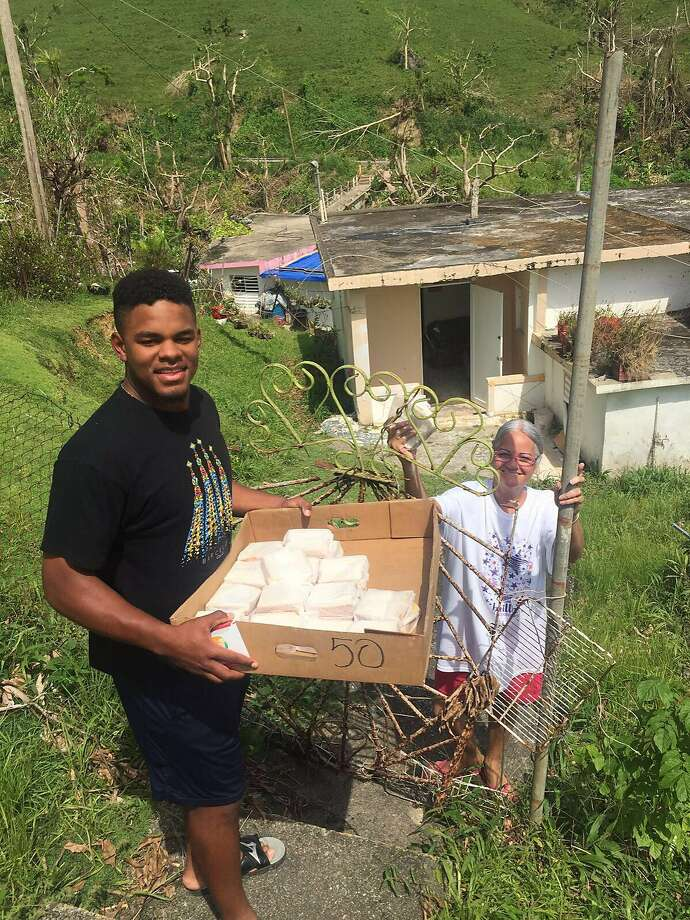 Heliot Ramos, the Giants' first-round pick in 2017, delivers sandwiches to survivors of Hurricane Maria Matuyas Alto, Puerto Rico Photo: Heliot Ramos