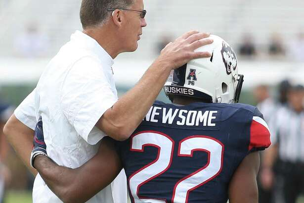 UConn coach Randy Edsall puts his arm around senior running back Arkeel Newsome before facing Central Florida on Nov. 11 in Orlando, Fla.
