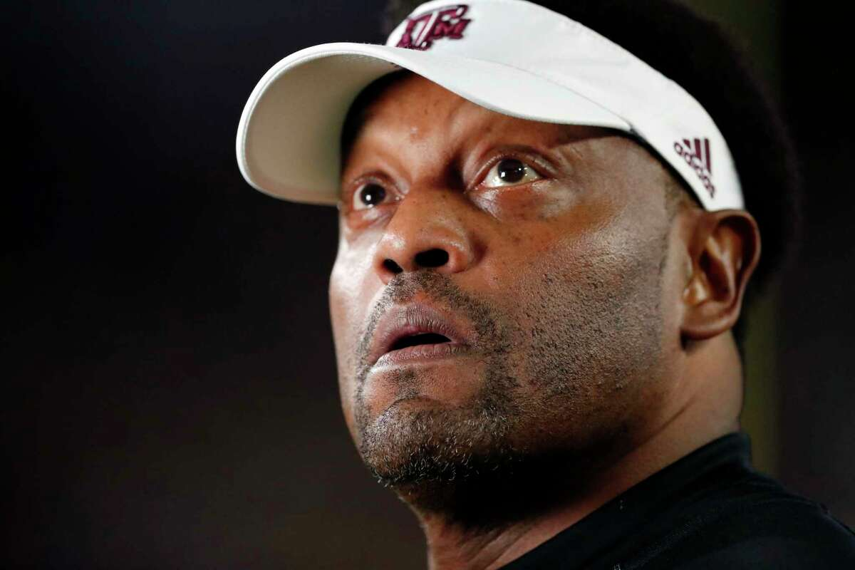 Texas A&M head coach Kevin Sumlin looks at the scoreboard prior to an NCAA college football game against Mississippi in Oxford, Miss., Saturday, Nov. 18, 2017. (AP Photo/Rogelio V. Solis)