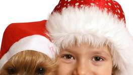 Need inspiration for a cute holiday photo? You can't go wrong with kids and/or pets.