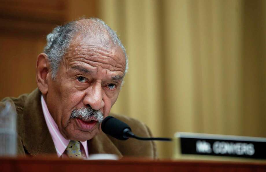 FILE- In this April 4, 2017, file photo, Rep. John Conyers, D-Mich., speaks during a hearing of the House Judiciary subcommittee on Capitol Hill in Washington. Buzzfeed, a news website, is reporting that Conyers settled a complaint in 2015 from a woman who alleged she was fired from his Washington staff because she rejected his sexual advances. Calls to Conyers and his office seeking comment were not immediately returned Monday, Nov. 20. (AP Photo/Alex Brandon, File) Photo: Alex Brandon, STF / Copyright 2017 The Associated Press. All rights reserved.