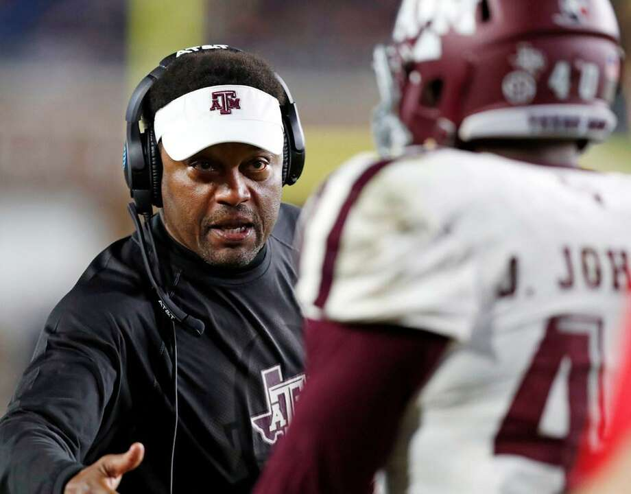 Texas A&M head coach Kevin Sumlin congratulates defensive lineman Jarrett Johnson (40) for helping stop Mississippi from getting a first down during the second half of an NCAA college football game in Oxford, Miss., Saturday, Nov. 18, 2017. Texas A&M won 31-24. Photo: Rogelio V. Solis /AP Photo