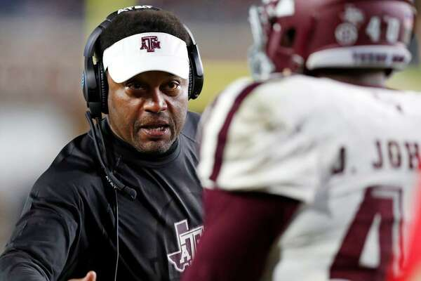 Texas A&M head coach Kevin Sumlin congratulates defensive lineman Jarrett Johnson (40) for helping stop Mississippi from getting a first down during the second half of an NCAA college football game in Oxford, Miss., Saturday, Nov. 18, 2017. Texas A&M won 31-24.