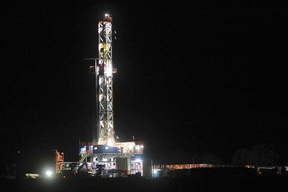 A drilling rig shines in the night near Three Rivers, Texas, on Thursday, Dec. 13, 2012. The number of drilling rigs at work in the Eagle Ford remained flat at 81 this week, according to Baker Hughes.